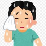 大量の汗をハンカチで拭き取る男性